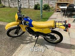 Classic 1986 Yellow Suzuki TS50X motorcycle 50cc